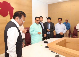 To give economy a boost, Rupani announces labour law exemptions for new projects/units