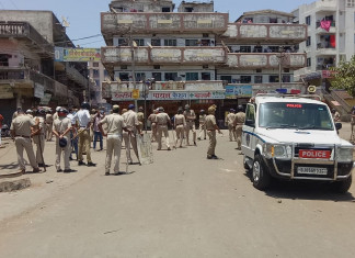 Migrants, police clash in Surat; stones pelted, tear gas used