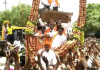 K'taka health minister violates own rules, fails to wear mask, maintain social distance at religious procession