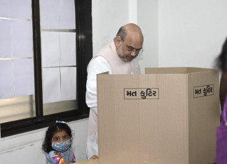 Amit Shah, family casts vote in AMC election