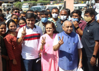 Nitin Patel casts vote, wishes BJP candidates