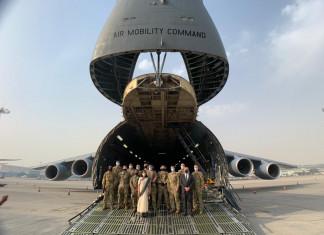 First batch of medical supplies containing 423 oxygen cylinders arrive from US at Delhi airport