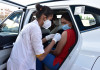 Drive-through vaccination begins in Ahmedabad, long queue outside Navrangpura stadium
